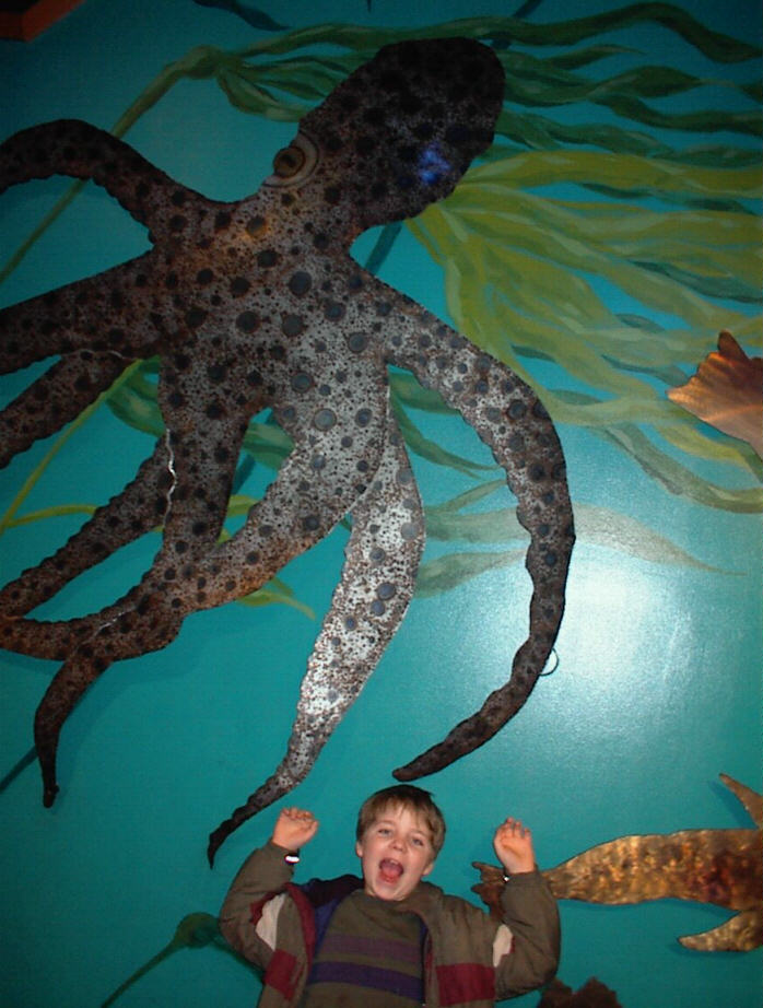 Kegan at the aquarium. Being eaten.